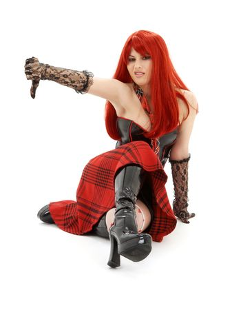 aggressive schoolgirl in black latex boots showing thumbs down Stock Photo - 1922350