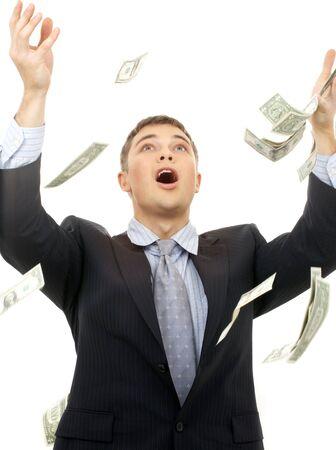 happy successfull businessman in money rain over white photo