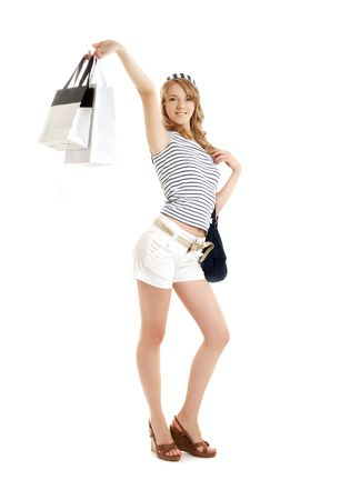 cheerful blond with shopping bags over white photo