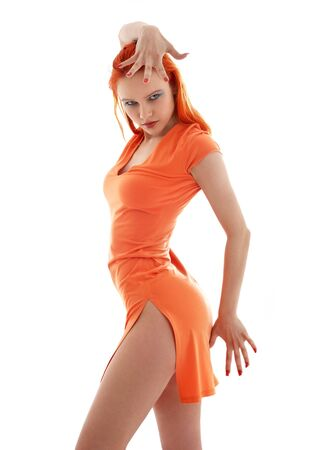dancing redhead in orange dress over white Stock Photo - 1962012