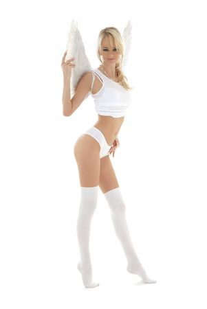 picture of lingerie angel blond in white stockings Stock Photo