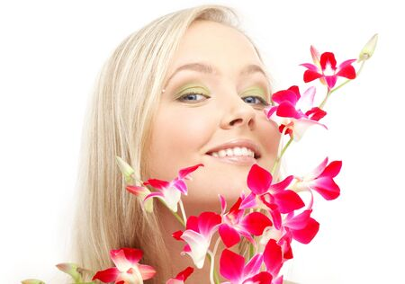 bright picture of lovely blond with orchid photo