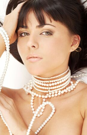 portrait of mysterious brunette with white pearls Stock Photo - 2033496
