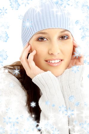portrait of lovely brunette in winter hat with snowflakes Stock Photo - 2072626