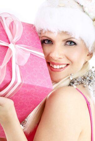 happy santa helper girl with pink gift box photo