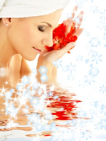 lovely woman with red flower petals and snowflakes in water Stock Photo - 2089932