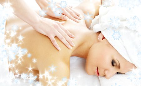 christmas picture of lovely lady relaxing in massage salon Stock Photo