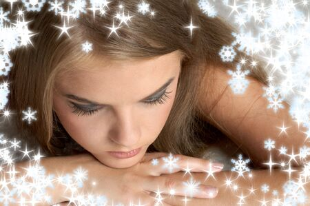 sad lonely girl: christmas portrait of pensive girl with snowflakes