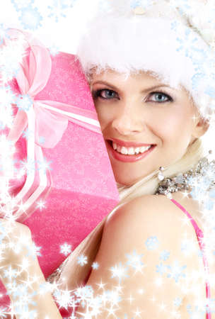 happy santa helper girl with pink gift box and snowflakes photo