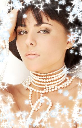 portrait of mysterious brunette with white pearls and snowflakes Stock Photo - 2177587
