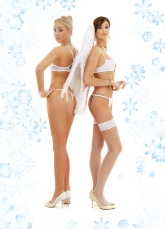 white lingerie christmas angels on high heels with snowflakes Stock Photo - 2168502