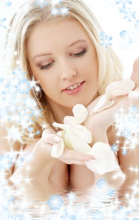 portrait of lovely blond with white rose petals and snowflakes in water Stock Photo - 2168504