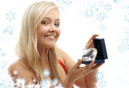 picture of lovely blond with big shining diamond and snowflakes photo