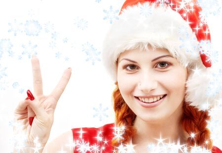 happy santa helper showing victory sign with snowflakes photo