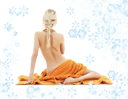 beautiful lady in spa with orange towels and snowflakes photo