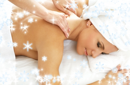christmas picture of lovely lady relaxing in massage salon photo