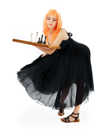 lovely girl with chess over white background photo