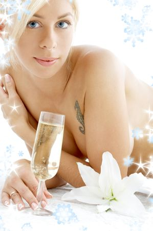 lovely topless girl with champagne glass, madonna lily and snowflakes Stock Photo - 2206441