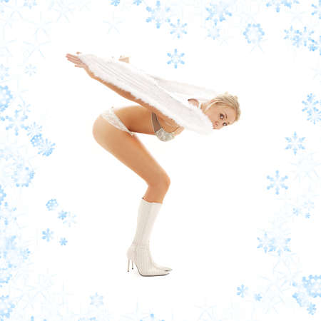 christmas picture of bending lingerie angel girl with snowflakes Stock Photo - 2221426