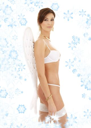 lovely brunette in white lingerie with angel wings and snowflakes Stock Photo - 2221429