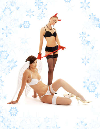 picture of angel and devil girls with snowflakes Stock Photo - 2221431
