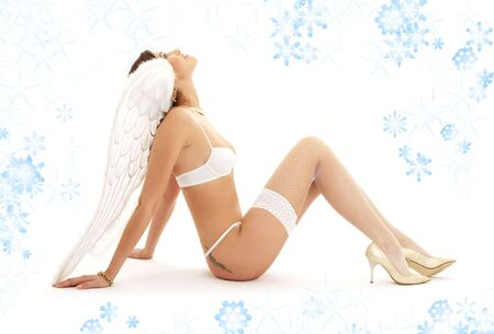 picture of christmas angel girl in white lingerie looking up Stock Photo - 2221434