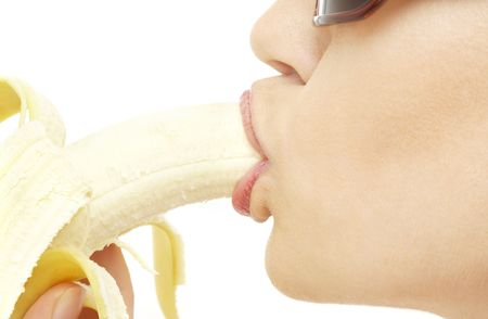 closeup picture of woman eating ripe banana photo