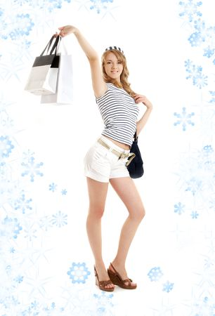 cheerful blond with shopping bags and snowflakes photo
