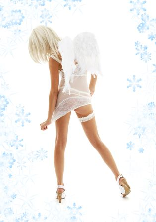white lingerie angel girl on high heels with snowflakes Stock Photo - 2241394