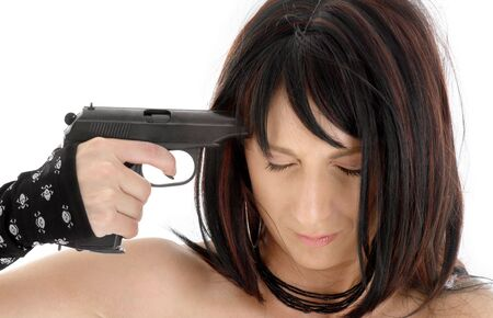 brunette girl pointing  gun at her head Stock Photo - 2241407