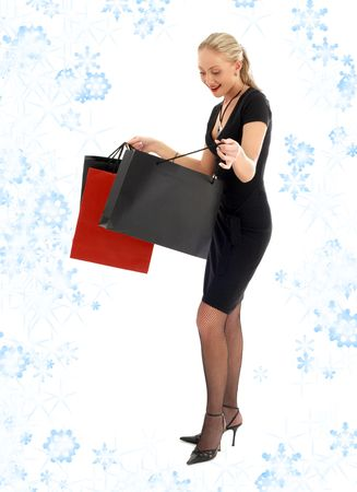 euphoric: euforico biondo con borse per la spesa con Fiocchi di neve