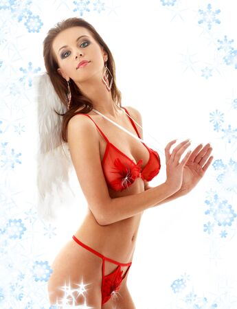 lovely girl in red lingerie with angel wings and snowflakes