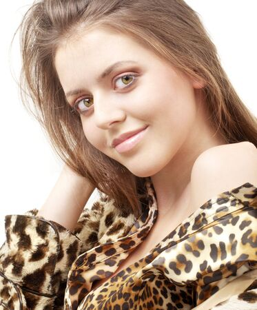portrait of lovely girl in leopard pattern clothes photo