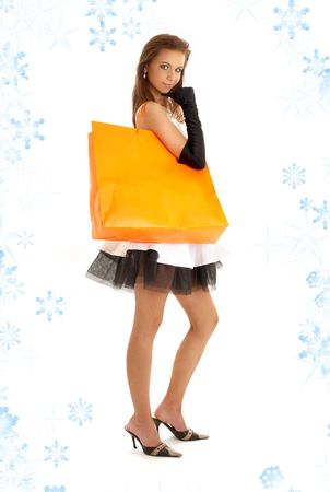 elegant lady with orange shopping bag and snowflakes Stock Photo - 2263532