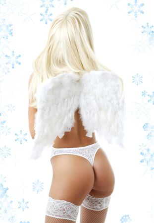 blond girl with angel wings and snowflakes photo