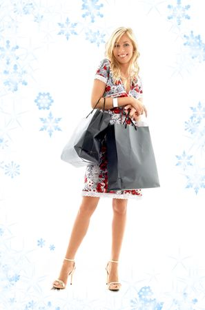 lovely blond with shopping bags and snowflakes Stock Photo - 2274512