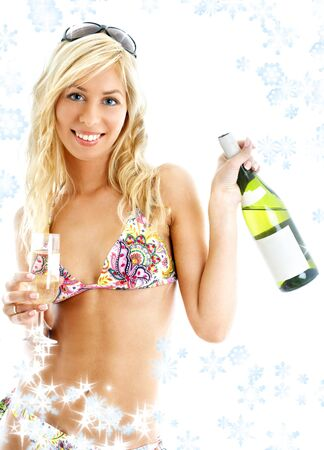 lovely blond in colorful bikini holding glass and bottle of wine with snowflakes Stock Photo - 2282255
