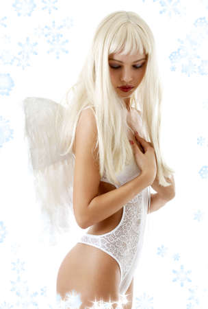 Blond hair girl in white lingerie with angel wings and snowflakes Stock Photo - 2299991