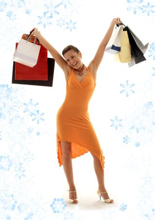 happy girl with shopping bags and snowflakes photo