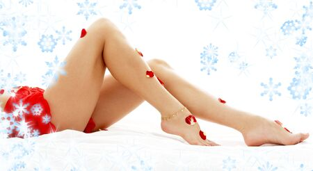 long legs of lady relaxing in spa with snowflakes photo