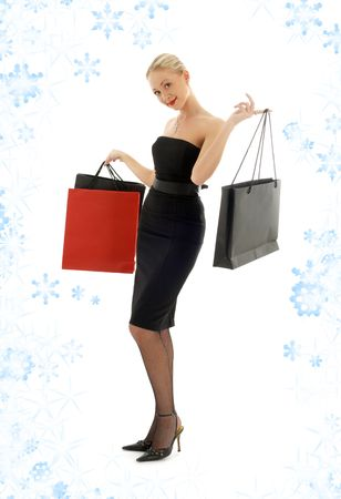 elegant blond with shopping bags and snowflakes Stock Photo - 2307422