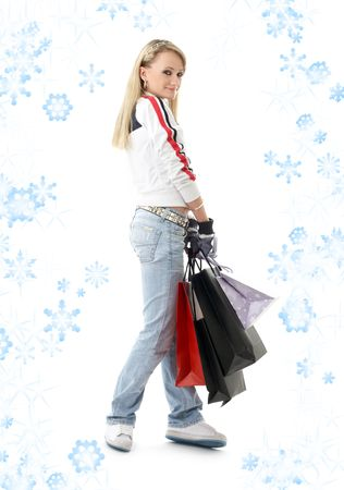 teenage girl with shopping bags and snowflakes photo