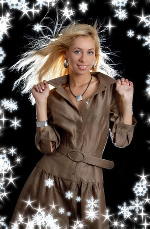 dancing blond in brown dress with snowflakes and twinkles photo