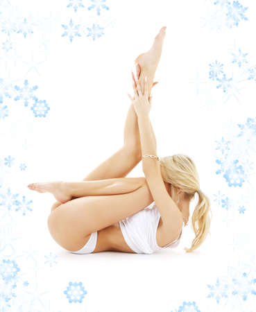 bodyscape: fit blond in white underwear practicing yoga with snowflakes