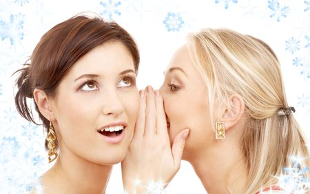 bruit: two happy young girlfriends with twinkles and snowflakes Stock Photo