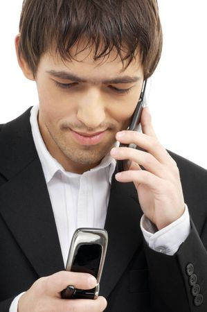 businessman with two cellular phones over white photo