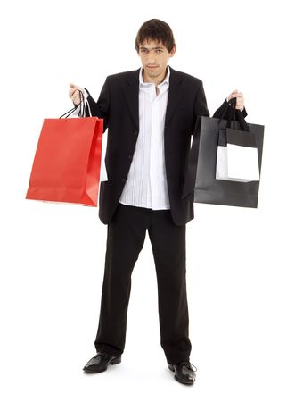 mania: handsome man with shopping bags over white