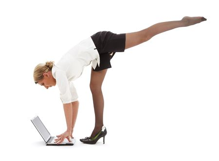 flexible businesswoman with laptop computer over white