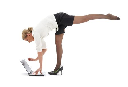 flexible businesswoman with laptop computer over white Stock Photo - 2415574
