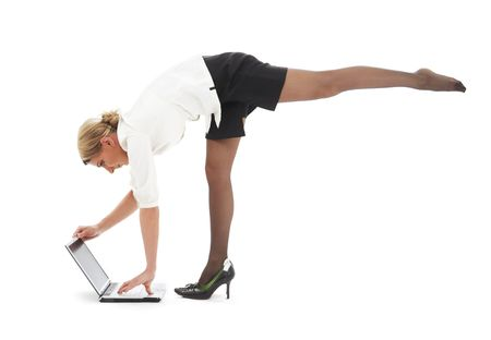 flexible businesswoman with laptop computer over white Stock Photo - 2415572